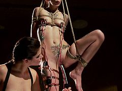 Krysta Kaos gets tied up from the ceiling with ropes and this domme bitch zaps her, and shocks her with electric current.