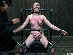 lady in bondage gets her tits clamped