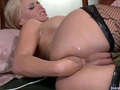 Lustful girls gape and then fist each others asses. Later on they suck a dildo and fuck one another with strap on.