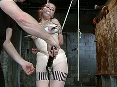 Redhead bitch Penny Pax gets bound and suspended in a cellar. Somebody fucks Penny's snatch with a toy and makes the whore moan loudly in pleasure.