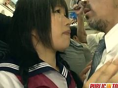This older guy seduces this schoolgirl while they are riding the bus. He determines her to give him a handjob.