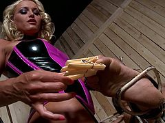 The girl is securely bound to a decrepit chair and waits her punishment in this great BDSM sex video. Wicked mistress clamps clothespins on slave's tongue, nipples, toes and pussy lips. Then she fingers her slave's hot snatch until she cums.