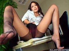 Look at her legs! THey are so sexy, when she wears these nylon stockings. Honey pulls her skirt up and bends over to show her petite ass. Then she gives a nice footjob to her man!