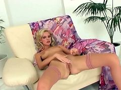 Watch a sexy blonde slut wearing pink stockings while flaunting her hot body. She loves playing with her dildo while left alone!