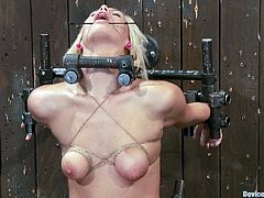 Cute blonde Tara Lynn Foxx is playing dirty games with some dude in a basement. She lets the man put her into irons and enjoys a toy moving back and forth in her warm depths.