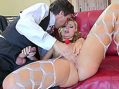 Tempting blonde hottie Jessie Rogers with arousing heavy make up and delicious ass in fishnet pantyhose and high heels gets licked and fingered to orgasms rough by fucker in suit.