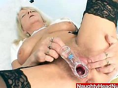 Grandma in uniform spreads her blond shaggy crotch