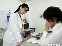 This student is in needs of some one on one tutoring with his teacher, Hitomi Oohashi. She kisses him passionately and tears his clothes off. She licks his crotch while he is still wearing his underwear then pulls his cock out and starts to suck it.