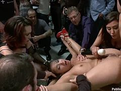 Insatiable whore Vicki Chase is lying nude in some crowded place. Some guys come up tp her by turns and poke their cocks into her mouth and pussy.