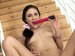 Slim Kity toys and fingers her hairy pussy on the stairs
