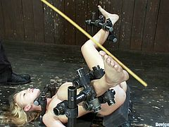 A hot blonde chick gets tied up with devices and toyed with in this hot bondage scene packed with perversion, check it out!