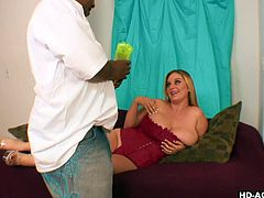 This black guy is used with busty ladies but April is something new for him! He never thought that a white chick can have such jugs and now finds out the fun way! April allows him to massage her breasts with lotion and then goes on top of him and covers his face with her huge, white melons.