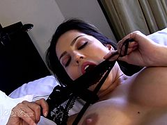 Sexy in black stockings Sunny Leone likes to pose while masturbating her warm cunt