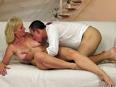Naughty and well stacked milf is cheating her husband with young next door guy. He pokes her in doggy style and makes her huge jugs bounce.