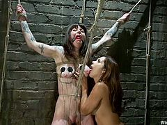 Two hot brunette girls make hot bondage show. Francesca gets hit with electricity and then fucked with the strap-on from behind.