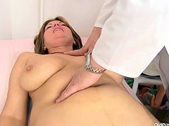 Bohunka is at the appointment to the kinky perverted doctor. She stands tall totally naked demonstrating her chubby curvy body with huge boobs. The Doc measures her body and then orders to lie on a medical couch. Fat mommy follows all instruction submissively so he opens her pussy folds showing red bosomy cunt.