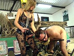 Dany De Castro is dressed in her kinkiest outfit. Her slave boy is gagged and blindfolded, then thrown over metal rods to get ass fucked. She make her boy toy lick her pretty toes and suck her massive cock.