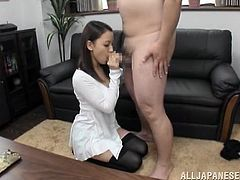Stunning Japanese girl with pretty face stands on her knees and gives hot blowjob to some fat guy. After all he cums in her mouth.