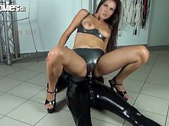 Tanja is covered by a latex suit and wears a strapon attached to her face and another one attached to her crotch. Angel Dark sucks the face toy and rides the other one.