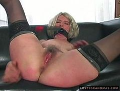 Kinky pale old nympho wears stockings and blond wig. Spoiled booty harlot gets a gag into her mouth. Then long legged whore with droopy big tits spreads legs wide to get her mature cunt fingered right away.