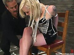 This sizzling blond babe gets belted down and gagged with a ball. Then her master puts her in the immersion tank and enjoys how hard she breezes.