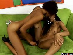 These chocolate skinned babes with slim bodies are rimming each other's succulent pussies using a double dildo in this hot lesbian sex scene.