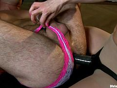 Only the thought of fucking her man in the ass makes this Divine Bitch horny. She got him all tied up with his legs spread, ball gagged and for some more humiliation he wears pink panties. The bitch then inserted a big strap on dildo deep in his ass and fucked him hard. She's ecstatic and wants more!