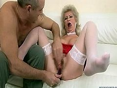 This is provocative X-rated porn clip of nasty granny with disgusting cunt. She has got bearded clam with huge vaginal opening. Perverted dude butt plugs granny while finger fucking her clam.