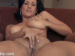 Watch this horny brunette fingering her pink pussy and rubbing on her delicate clit as she moans after showing you her big tits.