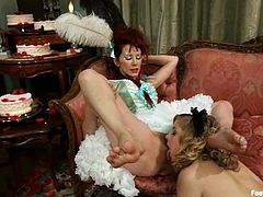 See the kinky foot fetish and strapon action in this hot lesbian video with Maitresse Madeline and Penny Pax.