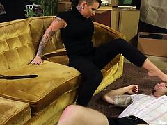 Christy Mack's slave Wolf Husdon is sucking on her toes and licking her soles. She steps on his face and stick her painted toes down his throat. He sniffs the bottoms of her feet and she sticks her toes up his nose. She looks super sexy in her leotards.
