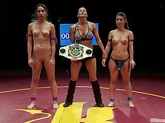 After a tight match of wrestling, the referee decides that Serena is the winner. She receives her winners belt and a strap on dildo to spoil herself with the prize. The looser, Amber, goes down on her knees with submission and begins sucking Serena. Damn it, seems that she enjoys her place!