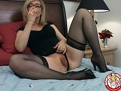 This horny mature bitch sucks on a hard fucking dick while wearing glasses and sexy lingerie and keeps at it till the fucker ejaculates in her mouth.