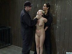 An arousing big titty brunette whore dominates a couple of slim blondies in this hot bondage scene right here, check it out!