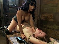Isis Love binds sweet brunette Sofia Lauryn and attaches electric wires to her boobs. Then Isis plays with Sofia's delicious vag and fucks it hard with a strapon.