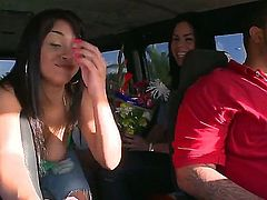 Lusty long haired brunette Isabella with juicy hooters and her hot ass friend in tight jeans have fun in bang bus and share stiff meaty cock in pint of view.