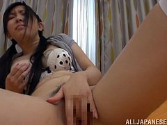 Naughty Mina Masshiro sits on a bed and toys her hairy pussy. After that she gets fucked nice and deep. She also gets a mouthful.