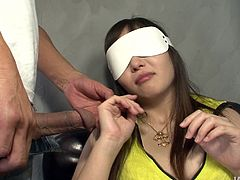 Haruka Oosawa is a sexy Japanese milf who's wearing a blindfold. She has a dick shoved into her face and she feels it before sucking it. Her tits and ass are kissed and her vagina is rubbed over top her panties.