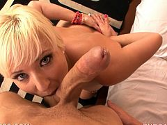 Nasty blonde girl lies on a bed and fingers her vagina. Then she comes up to a guy to lick the balls and suck a cock. She also gets her mouth filled with thick cum.
