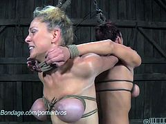 These two girls and tied up together and whipped by a dominant man. They are tortured and held captive.