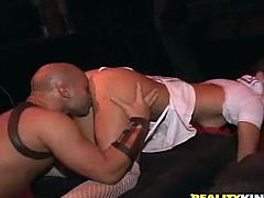 Horny brunette bitch Jessica Valentino wearing red fishnet stockings is having fun with some guy in a club. She sucks and rubs his schlong in public and then takes a great ride on it.