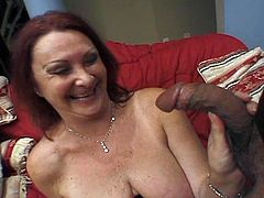 Check this vicious redhead milf devouring a black dong before her hairy pussy gets spectacularly banged by a horny black stud.