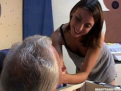 Slutty brunette sees a strange old man, who's surely mad. He's got a dummy in the mouth. Horn-mad chick with big tits desires to please this weird looking obese man. She sucks his old cock and gets fucked missionary right on the floor.