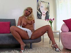 Hot blonde milf Nicki Hunter is having some fun with a horny dude in the living room. She gives him a hot deepthroat blowjob and lets the dude cum into her mouth.