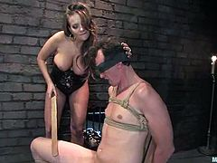 Stunning brunette girl ties the guy up and then tortures his dick. After that he gets toyed with a strap-on in his ass.
