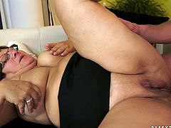 Lustful mature woman has got big saggy boobs. She is pleased with sex toy. Then she gives deepthroat blowjob. Later, handsome dude pounds her twat in a missionary position.