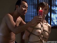 Hot Japanese bitch Reiko Sawamura is having fun with a few men indoors. The dudes bind the milf and then pour hot wax all over her body.