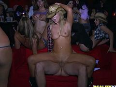 Jaelyn Fox and other insatiable bitches are having fun with some dude in a clu. The hussies eat each other's cunts and please the dude with a blowjob and then get fucked hard in cowgirl position.