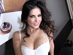 Slutty brunette Sunny Leone loves masturbaing her shaved twat in hot solo action