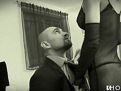 This brunette lady sits in a chair in the corner and masturbates as her husband gets his cock sucked by a slutty blonde whore. He kisses the whore and then she deep throats his cock. This turns on the wife very much.